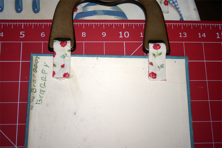 Attaching purse handles to book