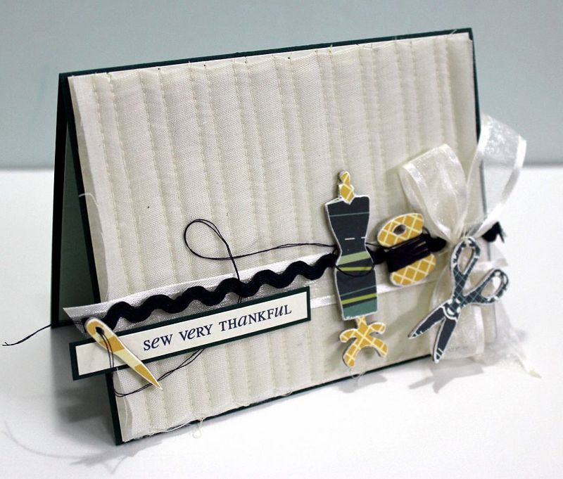 Quilted fabric background on card cosmo cricket