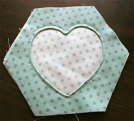 Sewing hexagon w reverse heart applique