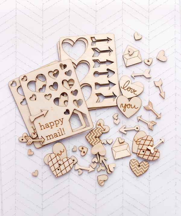 Wood charms hearts by Cosmo Cricket
