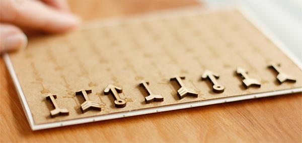 Spacing wood veneer on card